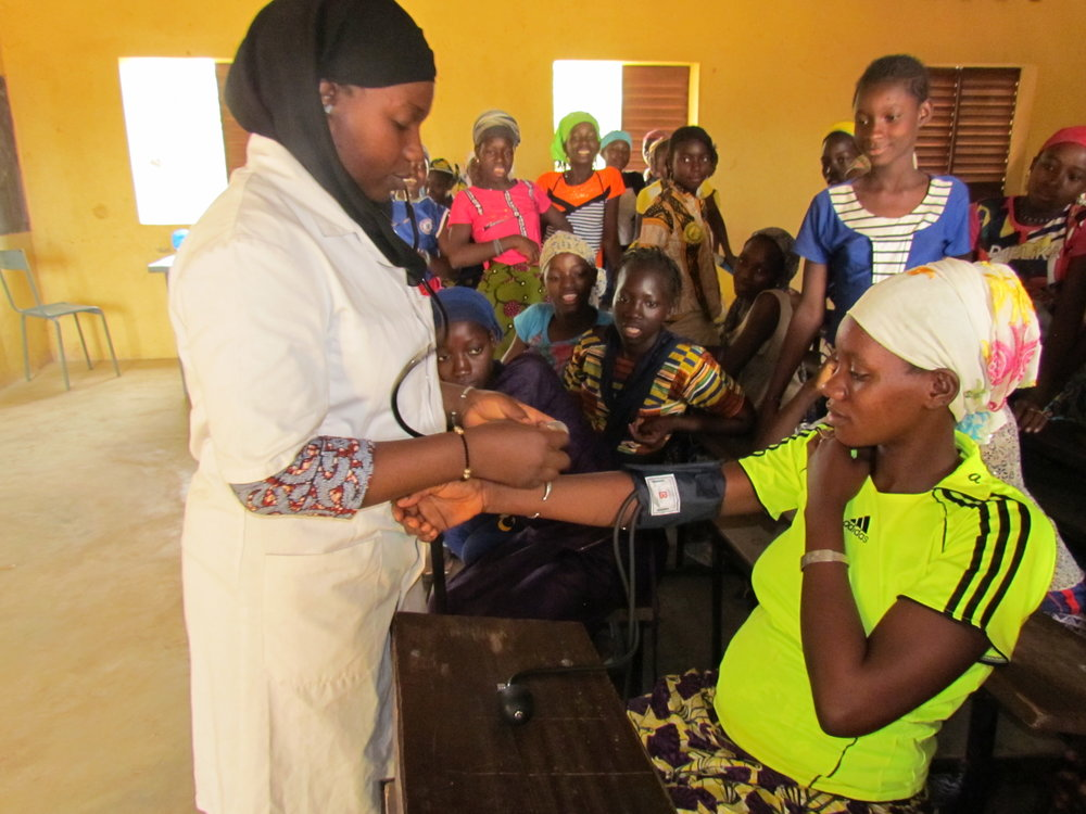 The girls vie to help demonstrate nursing skills.