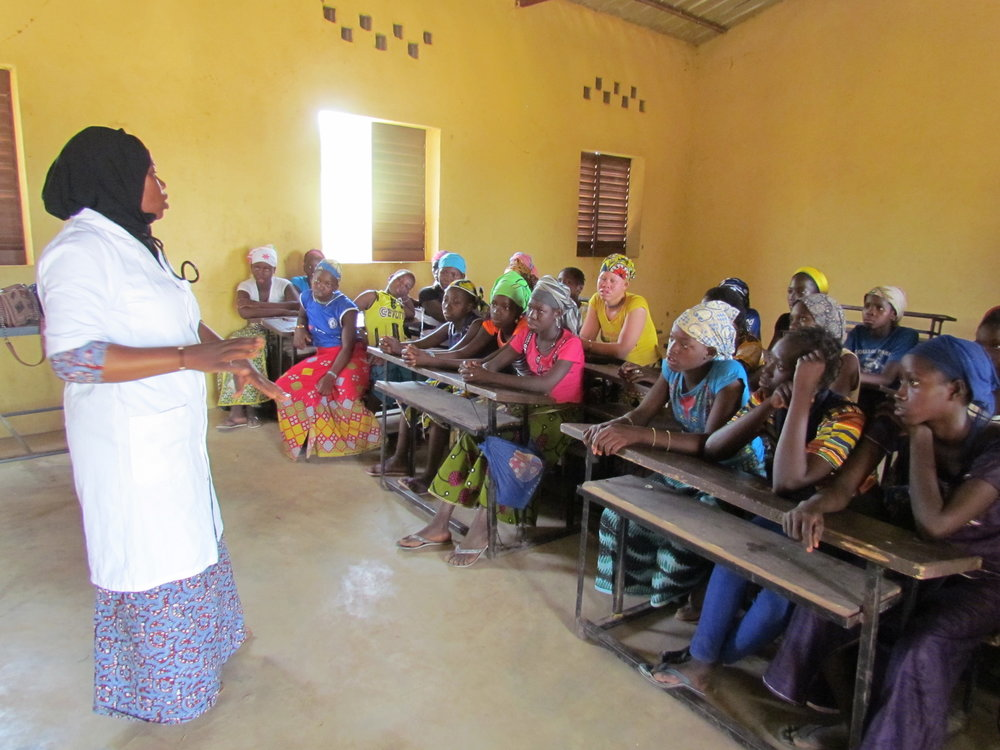 The girls of Kolimba listen intently as they consider what a career in medicine might mean for them.