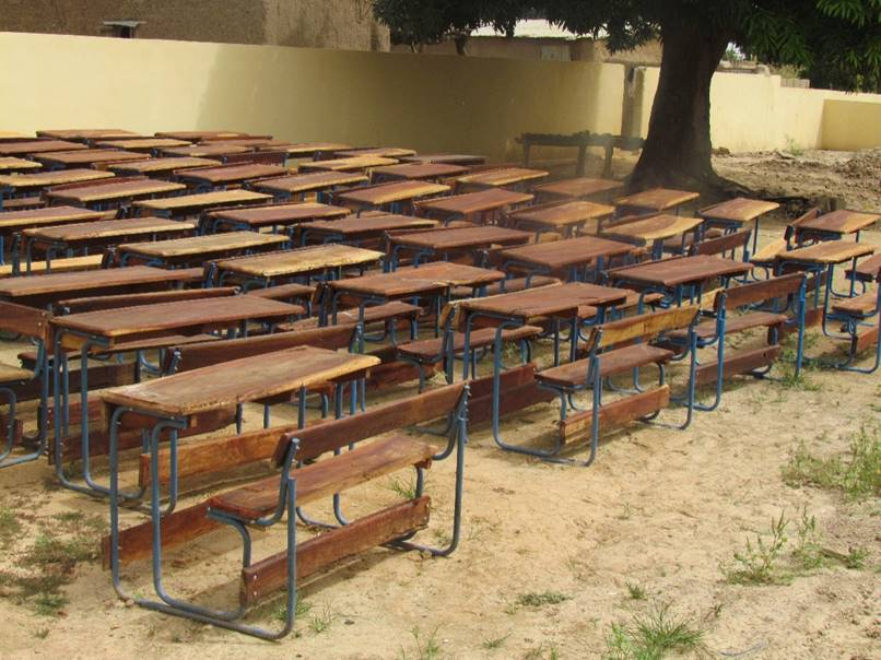 Desks wait to be moved to their classroom homes.