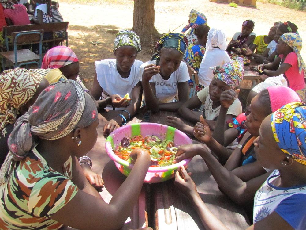 Enjoying their delicious dishes.