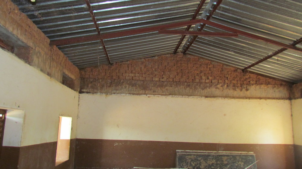 Inside a repaired classroom, after the removal of the bat infested ceiling but before replastering.