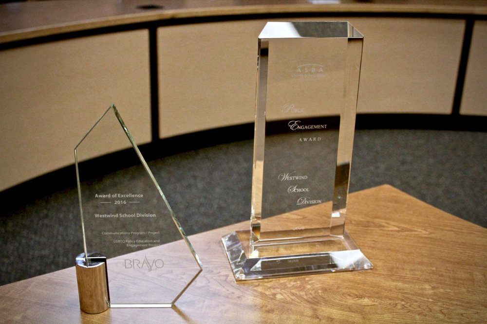 A picture of two glass awards for excellence in communications and public engagement.