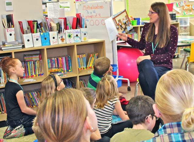 A photo of Westwind's 2015 Edwin Parr Nominee, Allison Groenenboom, reading a book to her students.