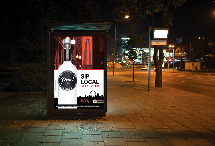 "Side view of a bus shelter ad for the  Pearl Vodka  ""Sip Local"" campaign."