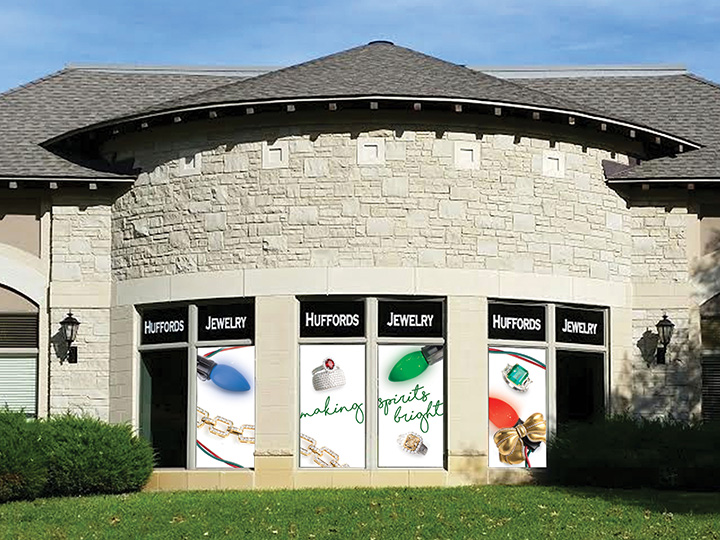 "Huffords Jewelry's ""Making Spirits Bright"" exterior signage, visible from Clayton Road in Frontenac, Missouri."