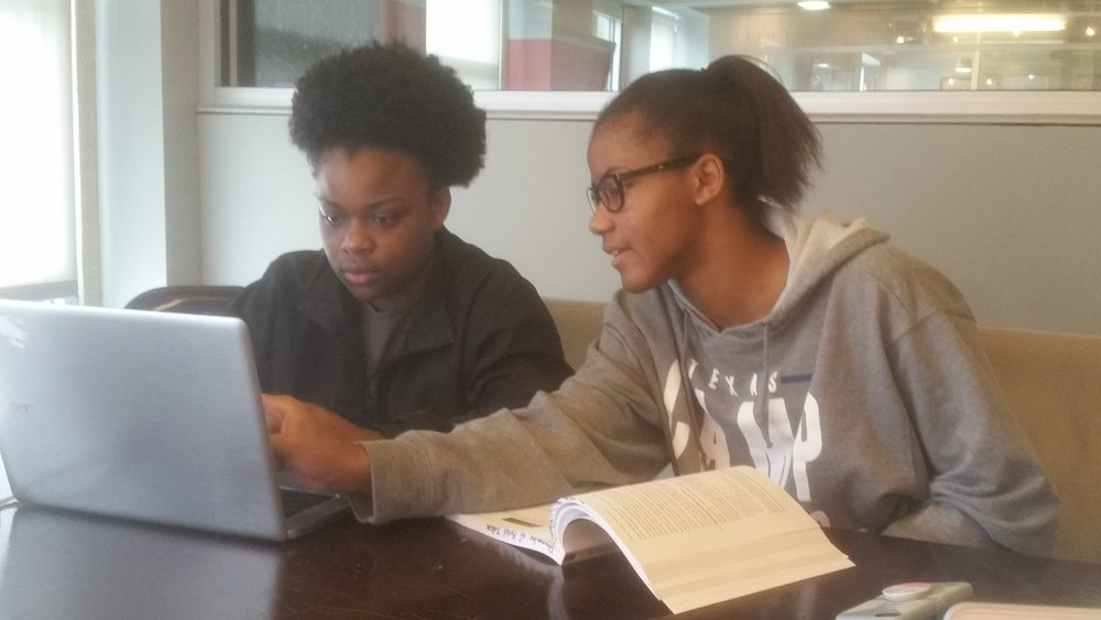 Bold Idea students Ascension (left) and MaKayla (right) are collaborating on a 3D game, which they're coding in Javascript with support from their mentor, Ben.