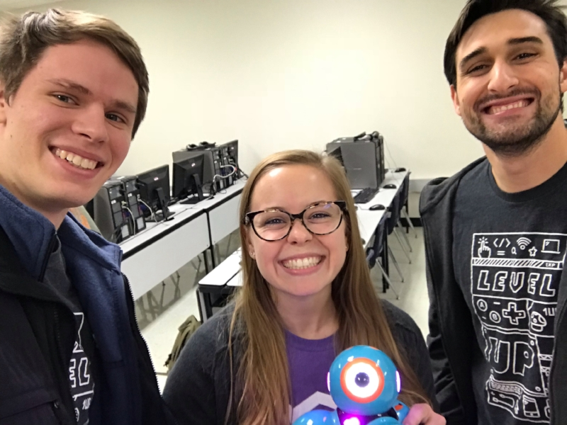 Brennan (right) with Bold Idea mentors Kevin and Nicki at Rosemont's STEM Night, 2018