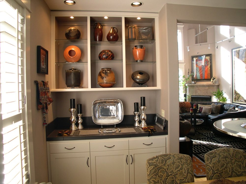 Before, the Dining Room shelves were not displaying the art objects to best advantage