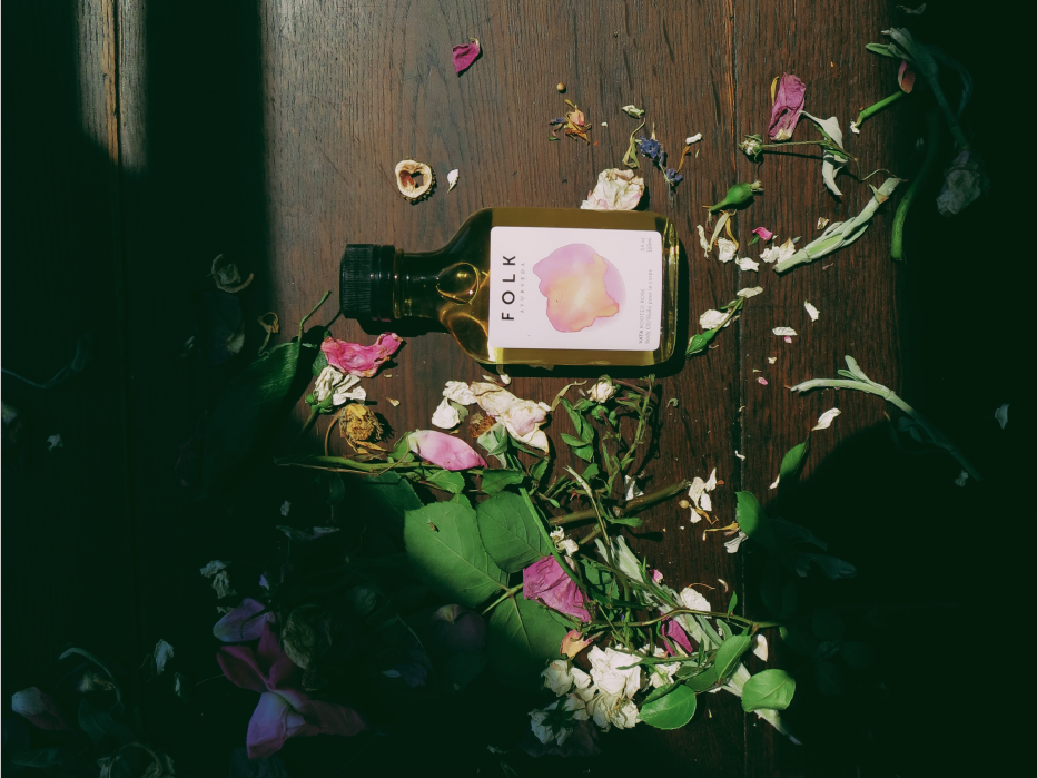Folk Ayurveda's Vata Body Oil is a rich combination of ingredients. Rooted Rose warms the heart, softens the skin, and grounds your focus with wild rose, cardamon, and pomegranate oil.  Purchase here.