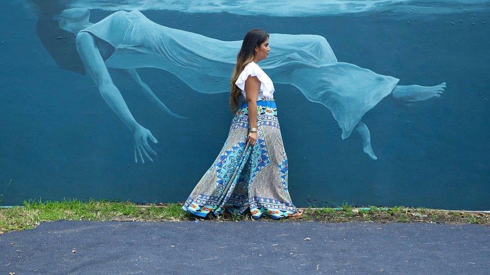 Ivette in front of R House Mural.jpg