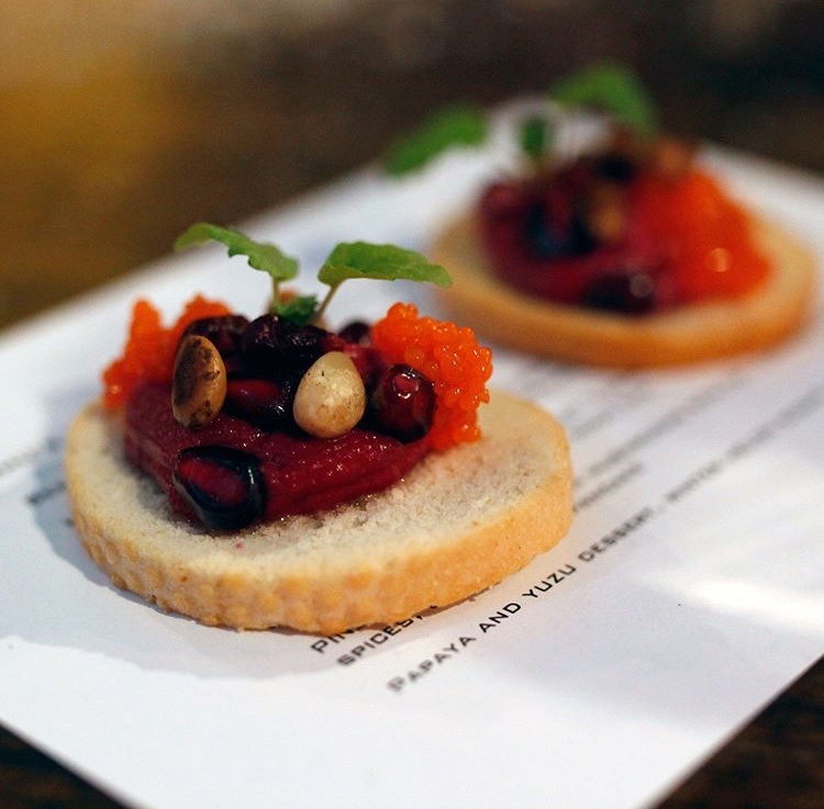 Beetroot cheese on biscuit, pine nuts, pomegranate