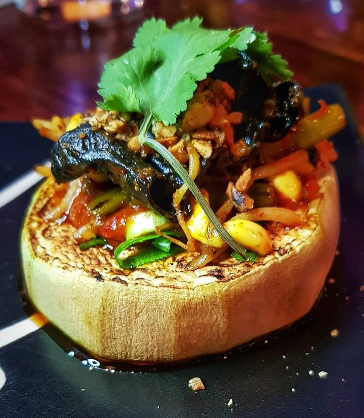 Grilled eggplant, 'Fish Fragrant' YuXiang gravy, garlic shoots, soybean shoots and wood ear.