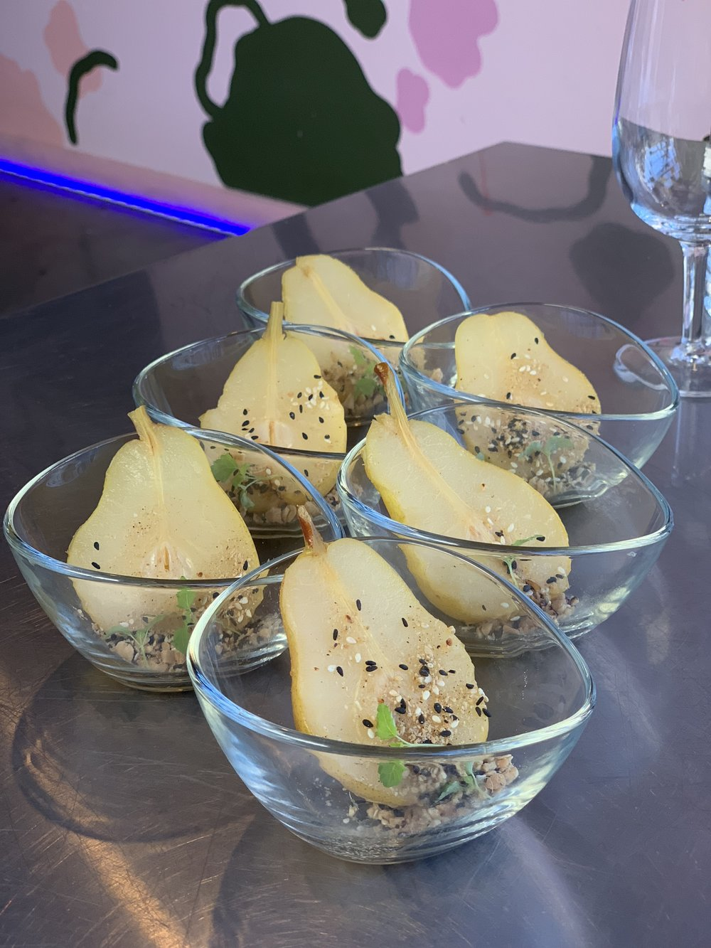 Poached Bosc pear in white wine, cinnamon and vodka, roasted peanuts and plum salt