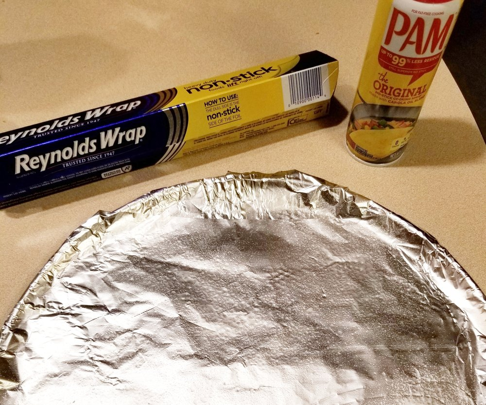 2. PrEP YOUR PAN - I like to cover my pan with non-stick aluminum foil, matte side up.Spray your foil lightly with pam. I've still struggled to get the zucchini off the pan in one piece using just pam or foil. Feel free to use one, or both as I do. Whatever works!
