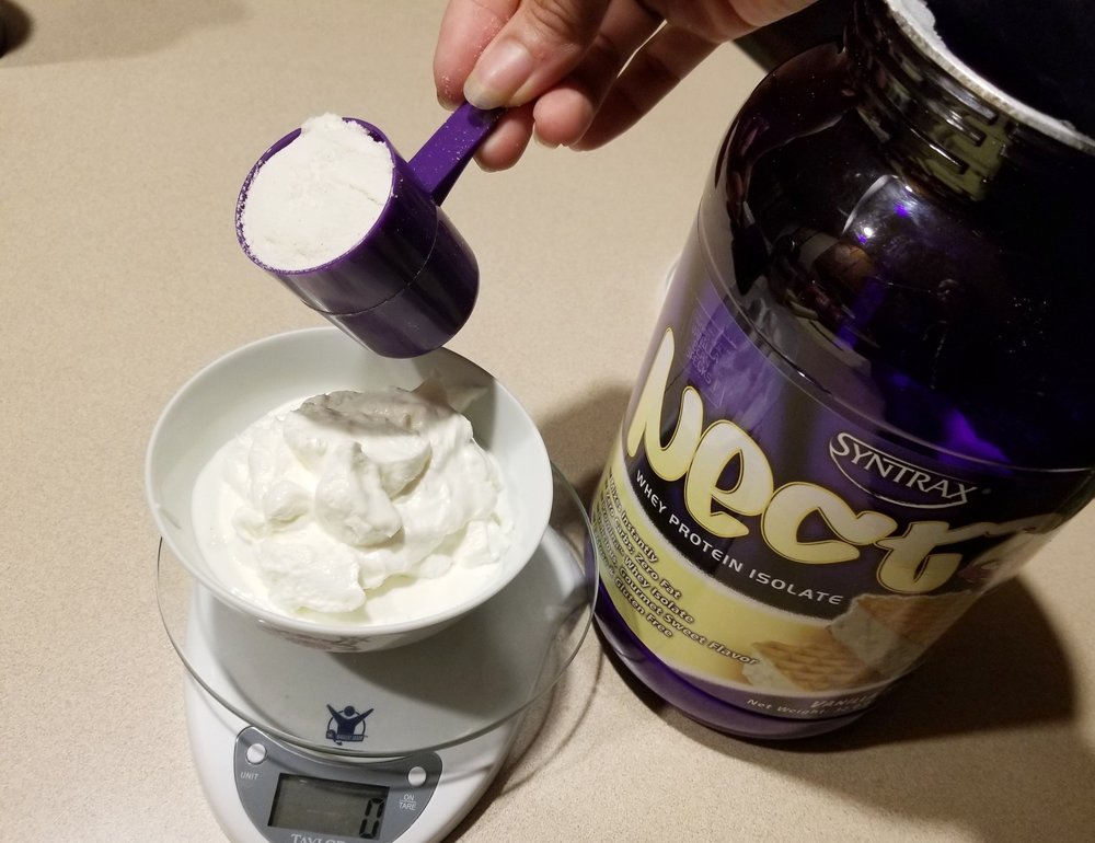 3. ADD YOUR PROTEIN - On top of your yogurt + whip, add1 scoop of vanilla protein powder. I'm using Syntrax Nectar Sweets in Vanilla Bean Torte, one of my faves.Protein powder makes all the difference here; get creative with using different favors. Make sure you're using a powder that you like,
