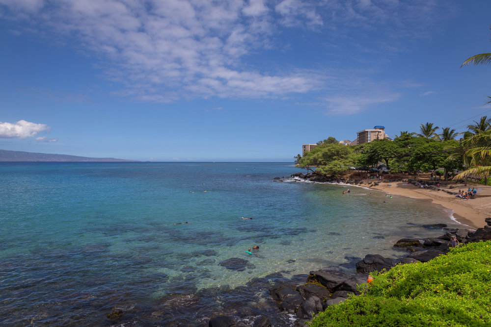 A short walk from The Sands of Kahana, Pohaku Park is a charming beach cove that offers excellent snorkeling and good swimming.
