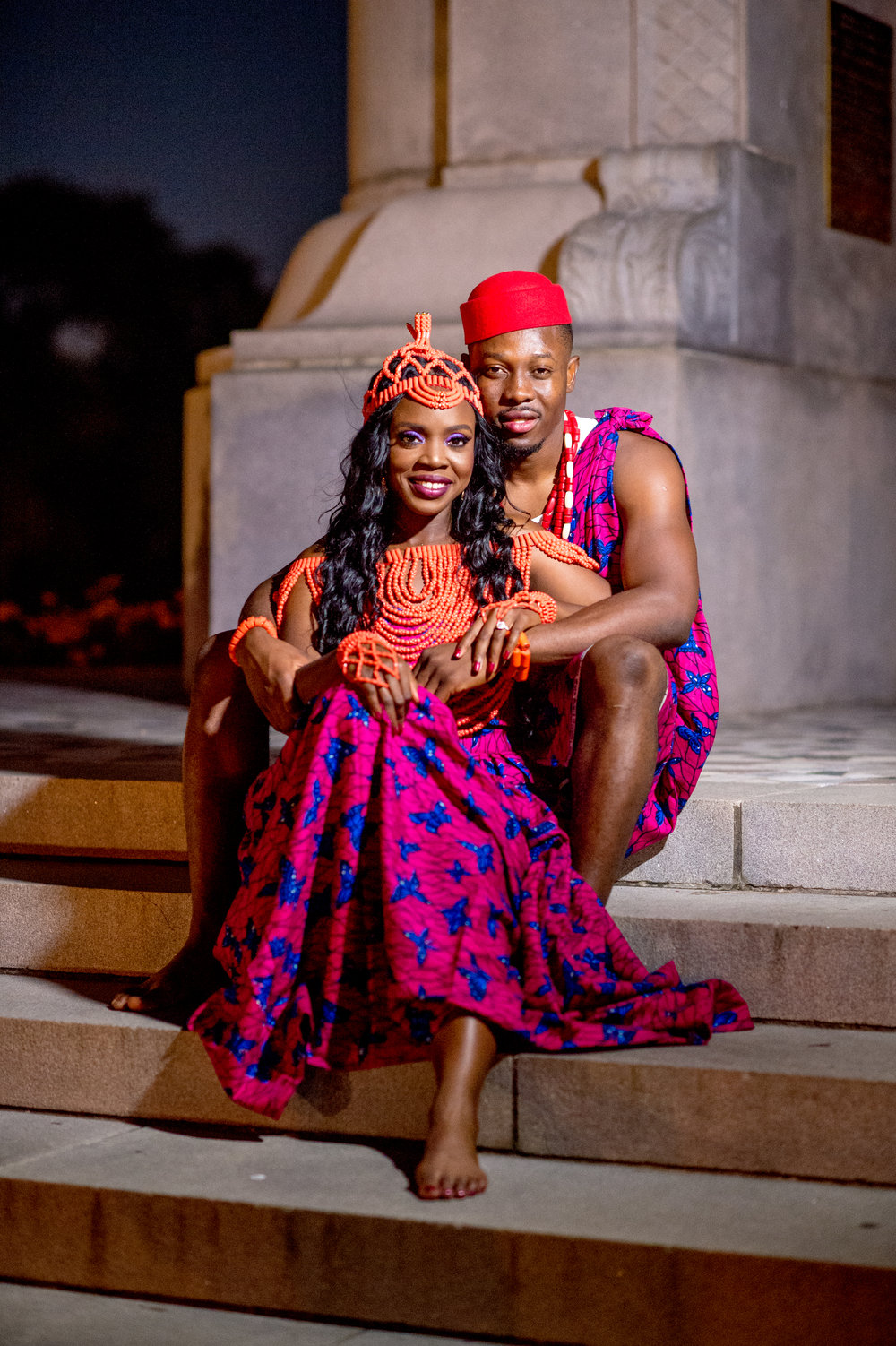 Notice the beaded details on her head, her neck, shoulders and hands. These coral beads she chose turned her into an Igbo princess and I love it! Nwabueze then took it a few steps further by adding the Red hat and beads as well.