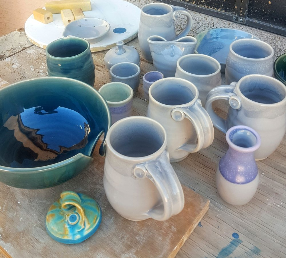 The results of my latest glaze firing (including my kiln shelf that now has a glaze drip I can't get off).