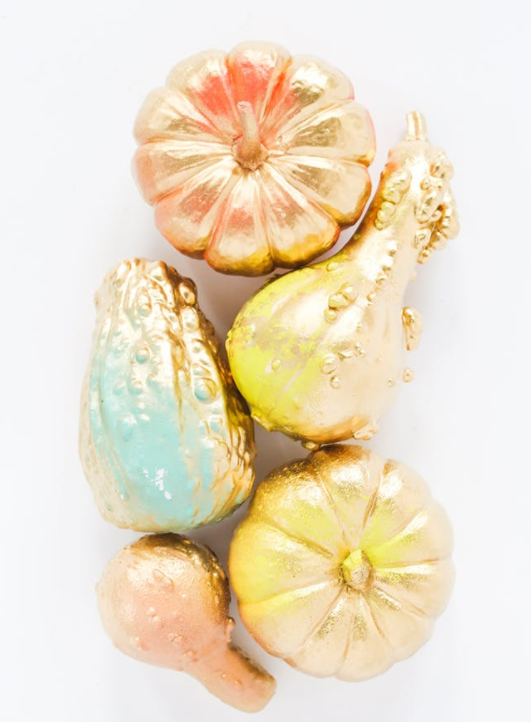3. Gold and Neon No-Carve Pumpkins:  These subtle gold and neon-painted pumpkins are a modern and trendy take on the traditional gourd. Put 'em on your sideboard or next to the main dish on your Thanksgiving table. (via  For the Makers )