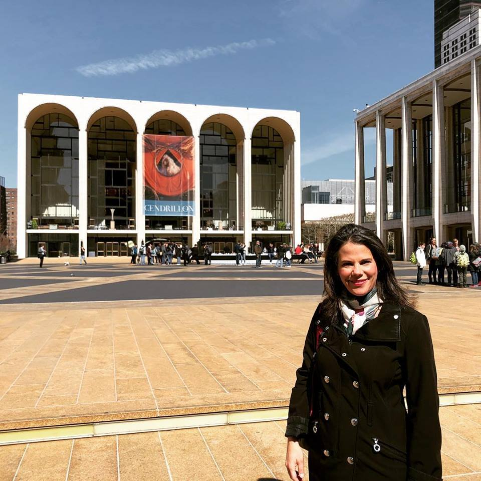 Kala Maxym stands in front of the Metropolitan Opera House in New York City