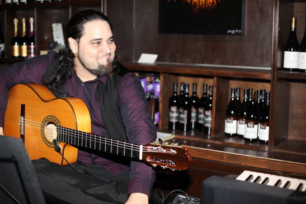 Flamenco guitarist Andres Vadin plays at V Wine Room in 2017.
