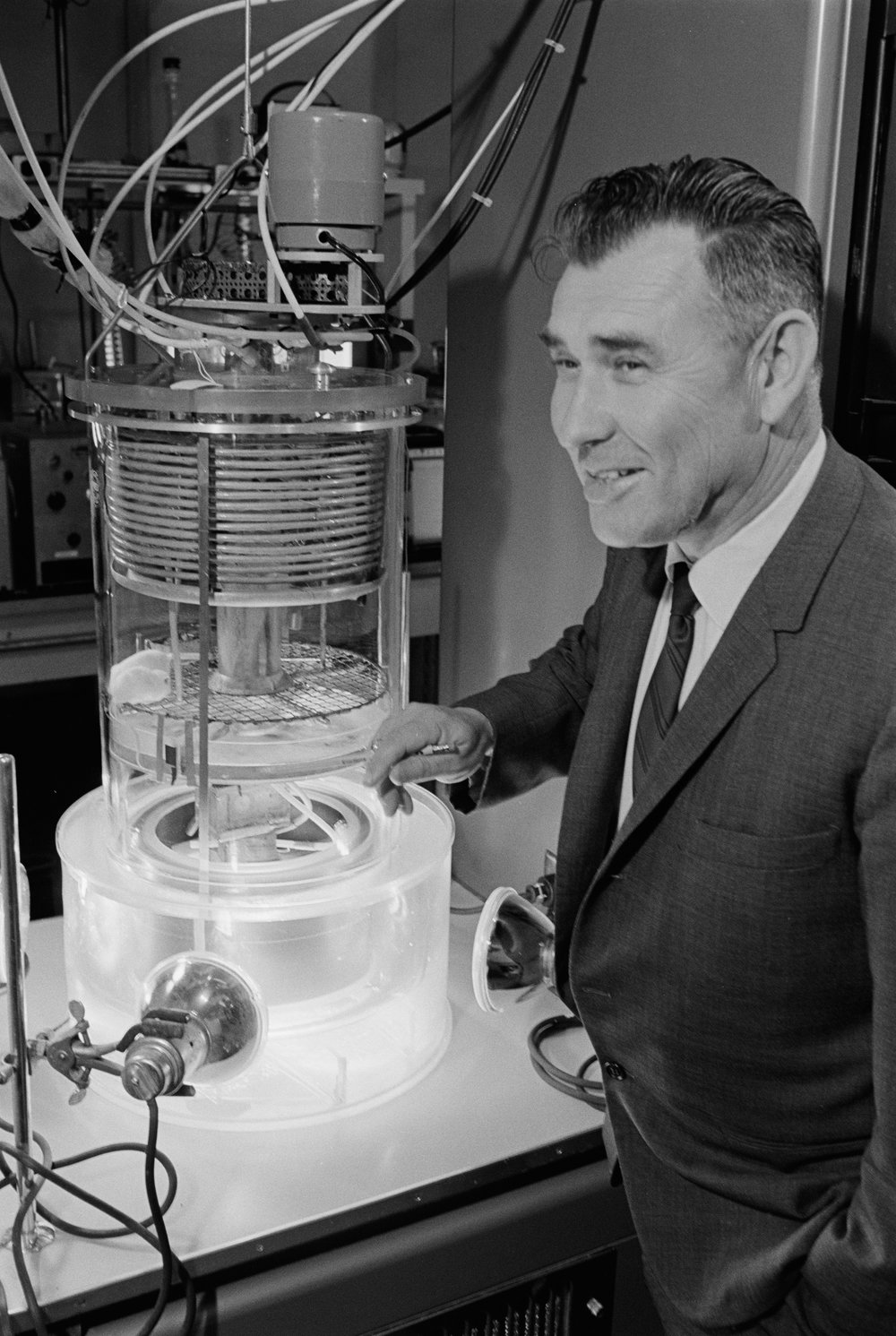 William Oswald and a model of the Algatron. The mouse in the upper portion is sealed inside the apparatus with its waste being recycled through the illuminated section at the bottom containing the rotating drum of algae!