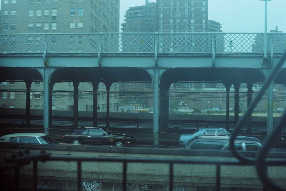 Williamsburg Bridge, 1980.  The view from my apartment on Delancey Street. The window looked out onto the Williamsburg Bridge. It looks like street level but is actually the second floor as the window was on the same level as the bridge. Most of the pictures from that time are gone but I'm glad this one survived as it reminds me of how cold that apartment was and the constant stream of traffic. Below the apartment was Attorney Avenue where they had a makeshift shop that sold live chickens that they would kill and pluck on the spot - and then hand you the warm body wrapped in white paper. I never tried their chickens but found the whole procedure horrifying and fascinating and couldn't take my eyes off it.