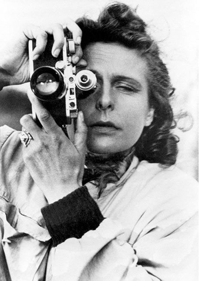 """Self Portrait  1939 Leni Riefenstahl The classical style adapted to photography and the closed frame seen to full effect, with the camera's two """"eyes"""" perpendicular to the frame as Riefenstahl's hands create a closed circle."""