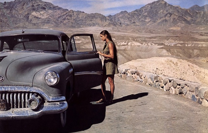 Zabriskie Point  The car, from the post-war era of black and white cinema, and the road barrier on the right form a triangle, and at the center is Daria.