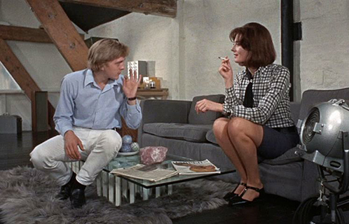 "Blow-Up  David Hemmings, Vanessa Redgrave. Thomas suggesting to Jane that in listening to music she must ""go against the beat."""