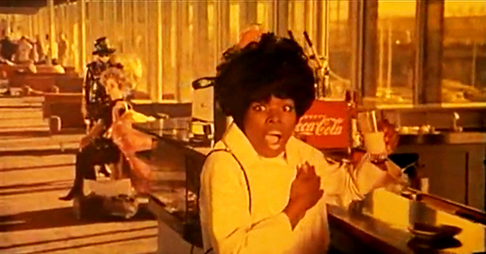 Toby Dammit The expression on the face signifies documentary while the background is clearly staged - even the Coca Cola logo behind the woman is contradicted by her incongruous glass of milk. - a world where everything finds its contradiction, its negation on the spot.