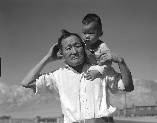 Manzanar, Man With Grandson, 1942  Dorothea Lange