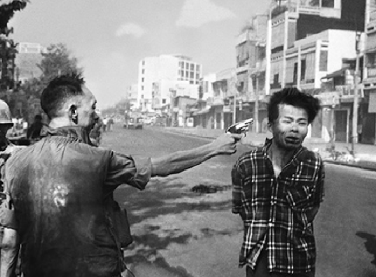 Murder of Vietcong by the Saigon Police Chief,  1968 Eddie Adams (Edited Frame as published)
