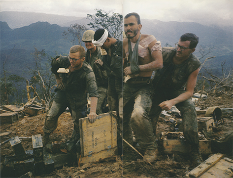 Larry Burrows,  Third Battalion, 4th Marines, wounded are helped to a helicopter evacuation area.  1966