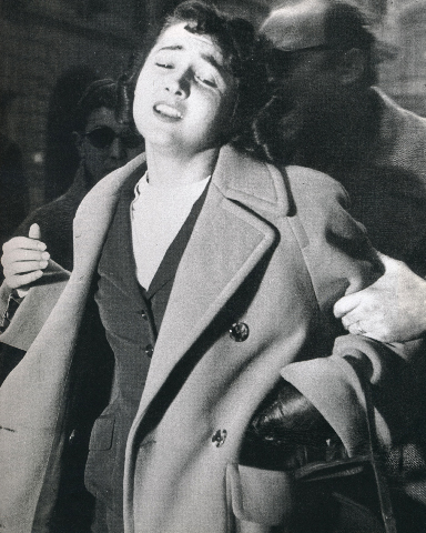 Tazzio Secchiaroli,  Witness at the Montessi Trial is Escorted to a Waiting Car,  1957