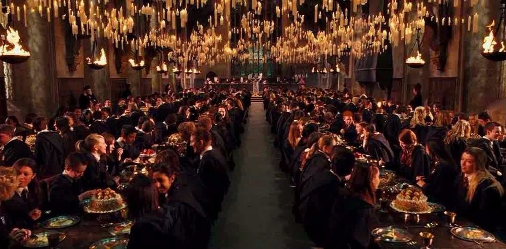 A magical candle-lit dinner in the Great Hall, Harry Potter.