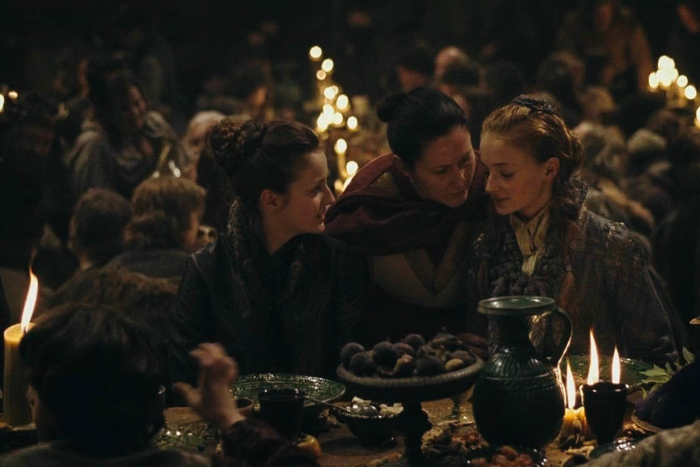 Sansa Stark at a feast (of deceit and cruelty!), in Game of Thrones.