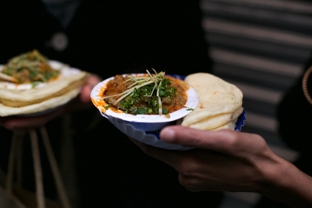 We stop for soft, warm kulchas paired with chole masala, a quintessentially Delhi dish. You can also have a glass of warm, spiced chickpea broth instead — equally delicious and full of 'takat' to survive the Delhi winter.