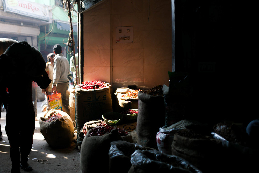 Anubhav takes us on a detour into a spice market. Up a stairwell at the back, he leads us to the rooftop, where the minarets of the old city are laid bare, and down below, the chaos of business is engulfed in swirls of dust and spice.