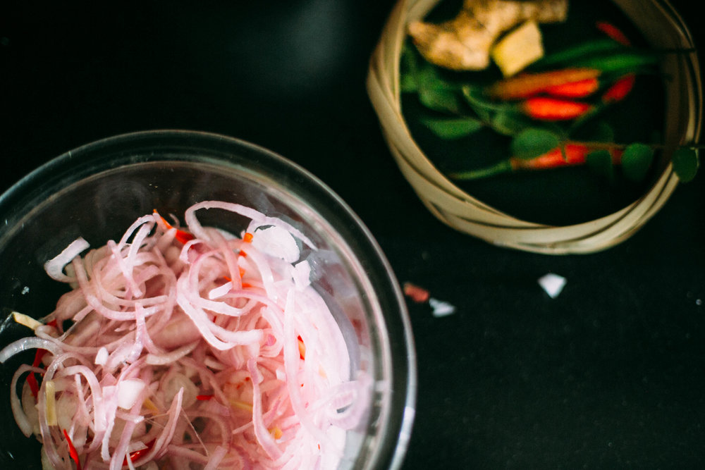 Onions and chilli in vinegar prepped for Brinjal in Coconut Milk | #1000Kitchens in her Bengaluru kitchen