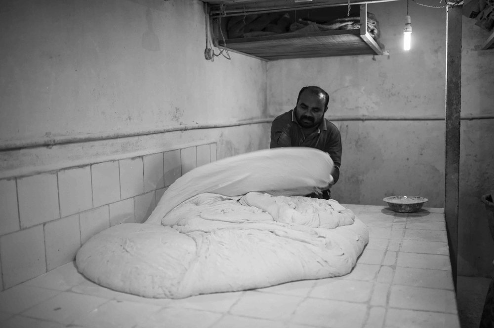 The rested dough is beaten out by hand to remove air and is left to rest some more which helps the bread to rise perfectly in the oven.  Shot in Gomez Bakery, Aquem Alto, 2017