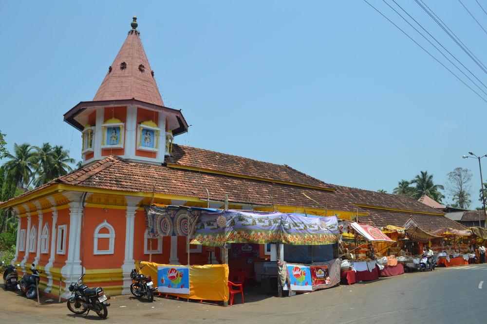 A village temple surrounded by stalls during a zatra or fair  Image credit: Arti Das