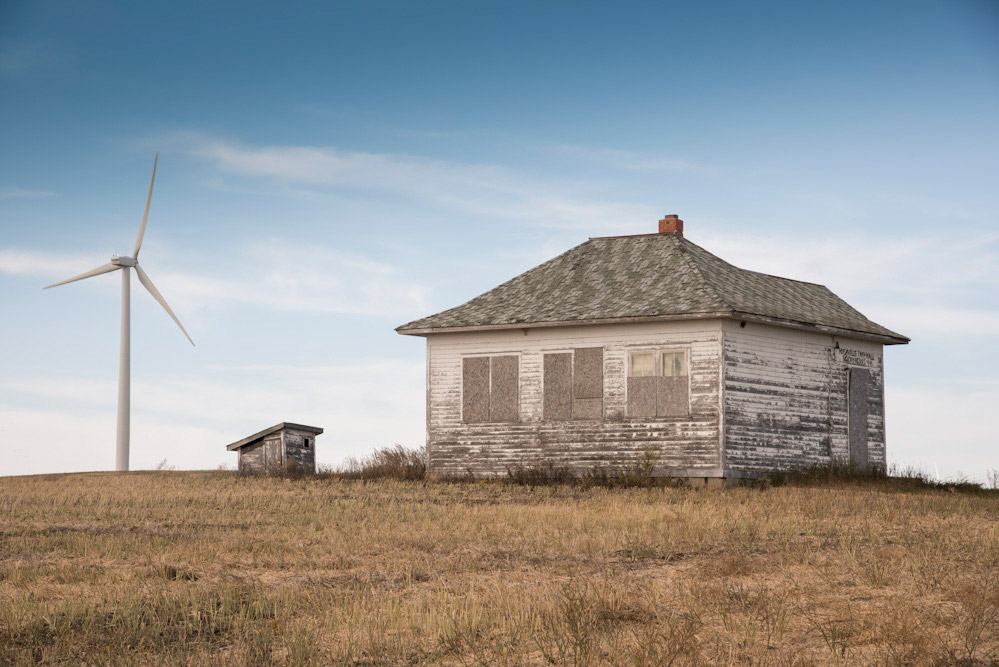 House with wind turbine, near Minot, North Dakota, USA