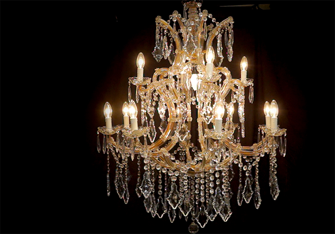 A striking crystal chandelier, like this one from Cheltenham Antique Market, forms a focal point to a room. Its rows of cascading crystal drops, reflecting the light, convey a sense of luxury.