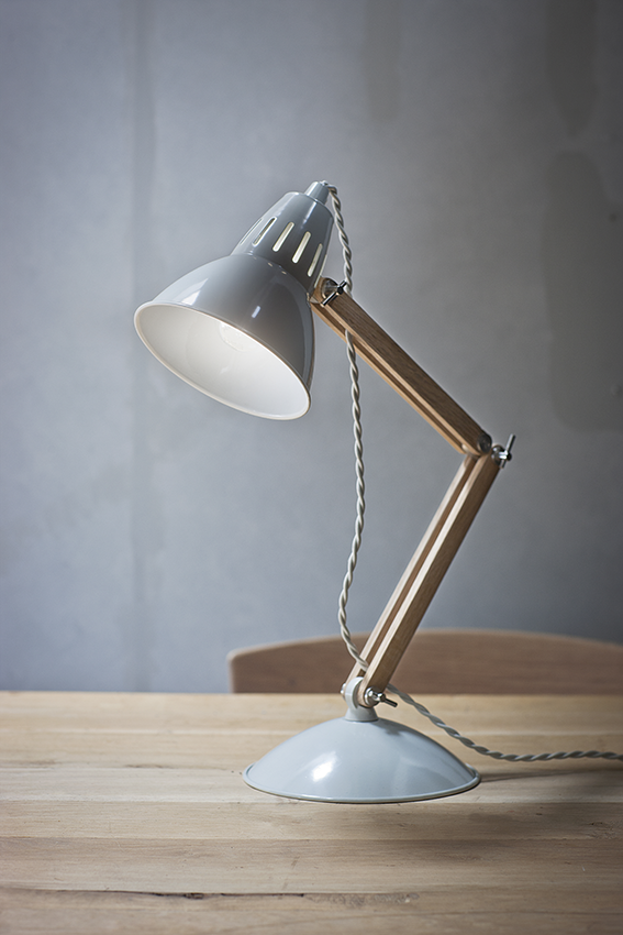 This Bermondsey Table Lamp from Cotswold Trading is a classic shape, with its powder coated steel head and base offset with a smooth and manoeuverable arm crafted from oak.