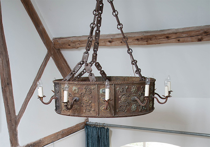 This early 20th century French iron chandelier from Lorfords is ideal for high ceilings or for adding an element of interest to any interiors scheme.