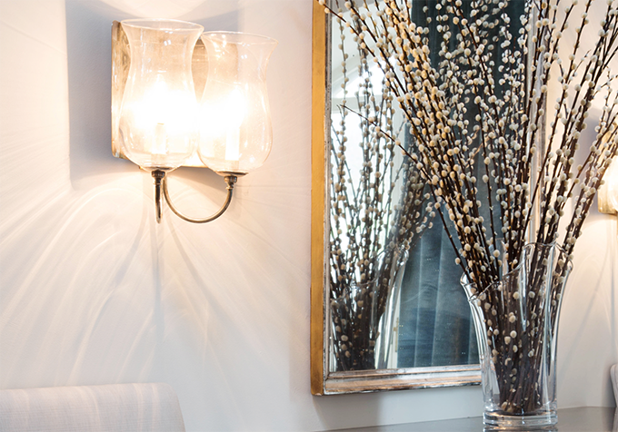 This contemporary silver plated two branch wall light, the Pimlico, can be found at Lorfords.