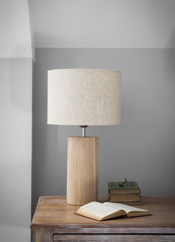 The neutral colour of the shade and natural grain of the elm allow this Hanborough lamp from Cotswold Trading to look at home in any setting.