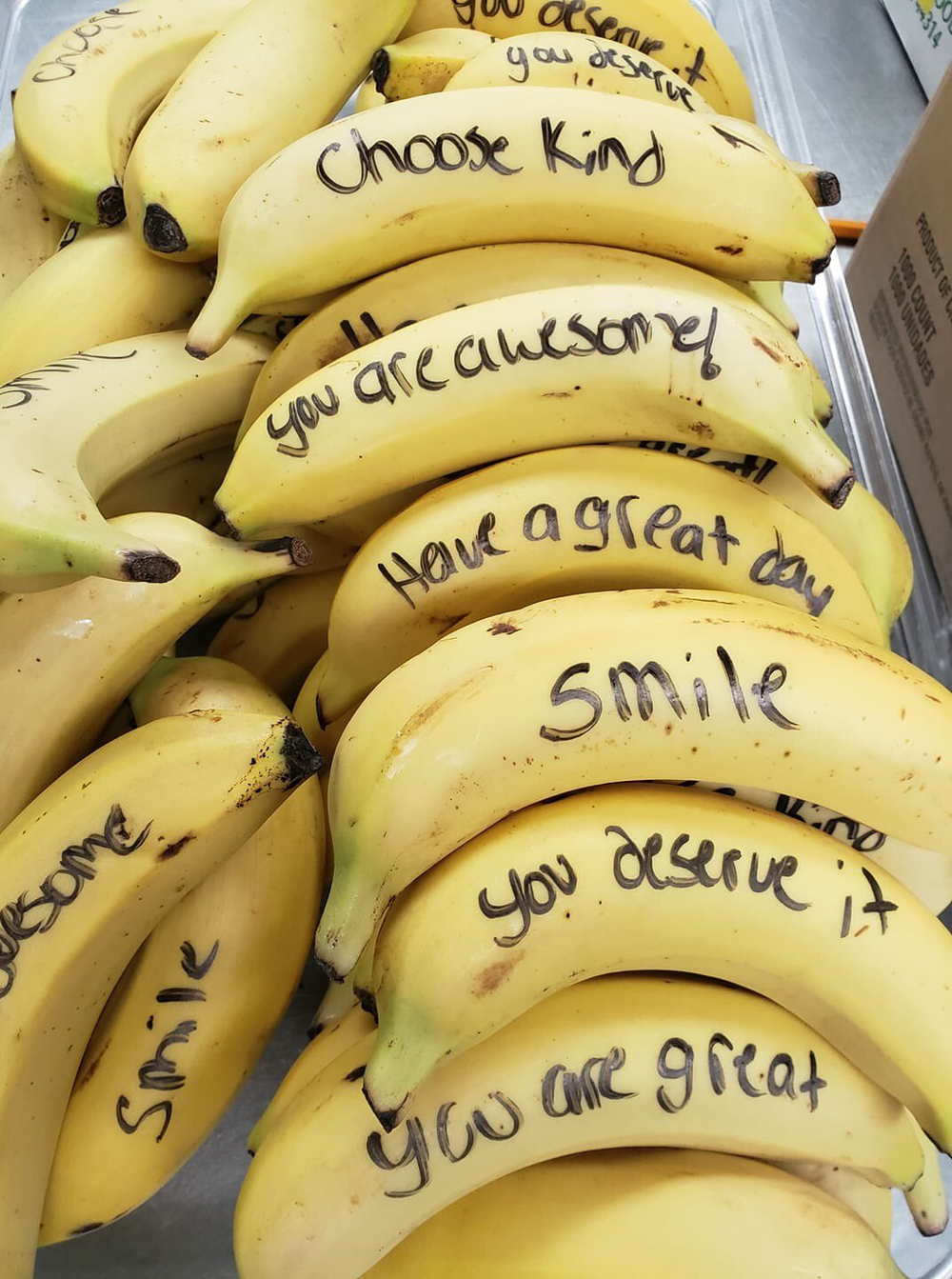 Bananas with positive messages written on them as a way to promote healthy eating.