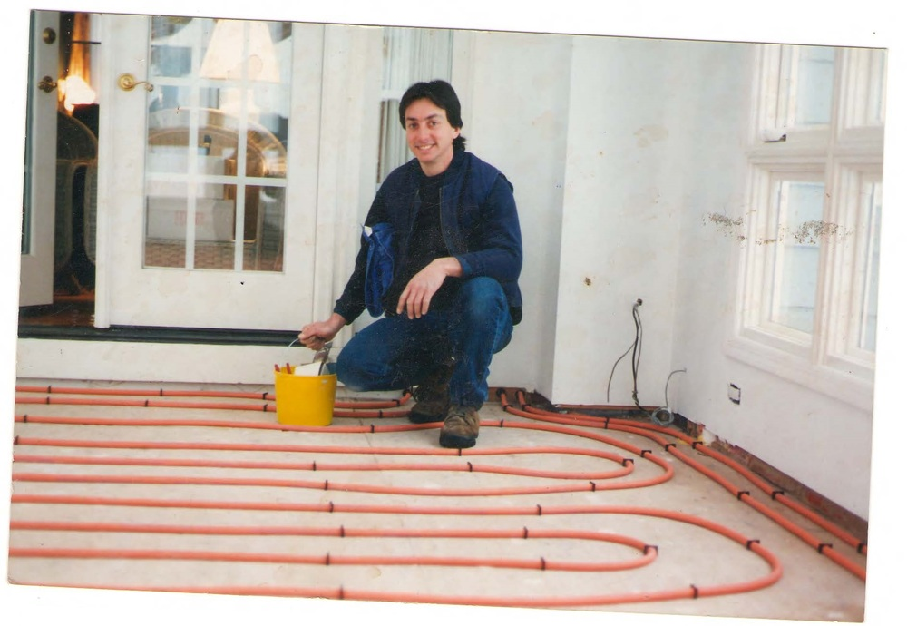 Tom installing radiant heating, a comfort heating system